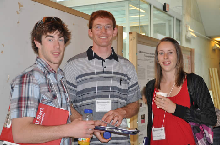 photo of three attendees in presentation area of Lassonde Building