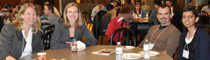 photo of attendees at table in Stong Cafeteria