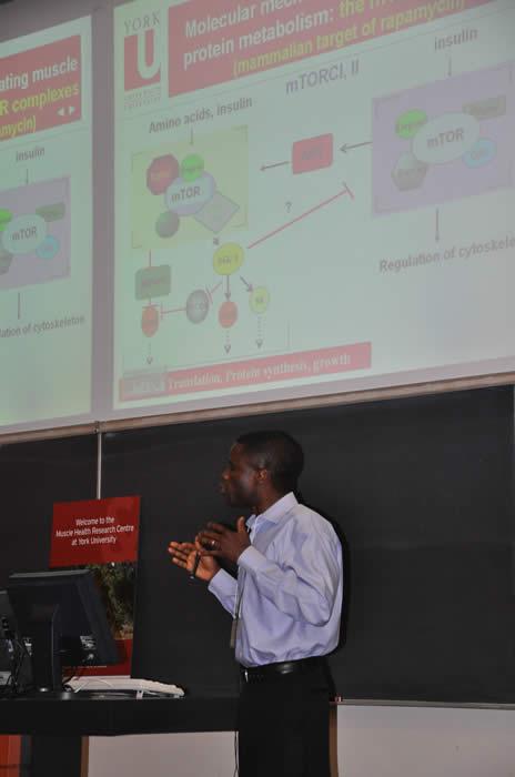 Speaker presenting work to audience