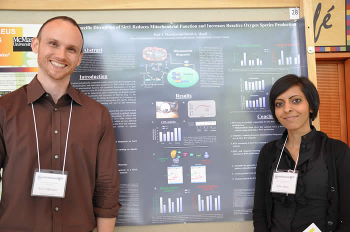 photo of a presenter pair and their poster