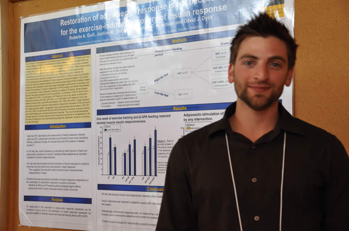 photo of presenter and his poster