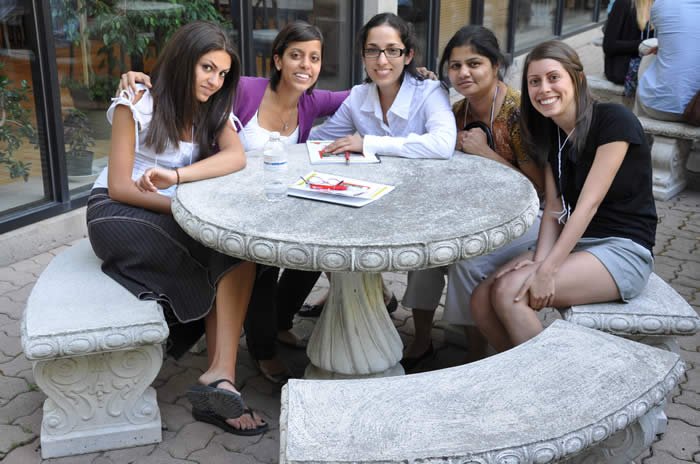 group of attendees at a table outside of Orange Snail venue