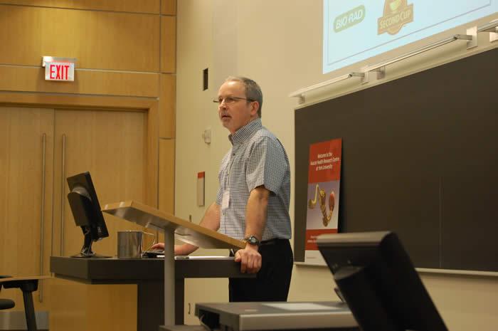 photo of David Hood speaking in Life Sciences room