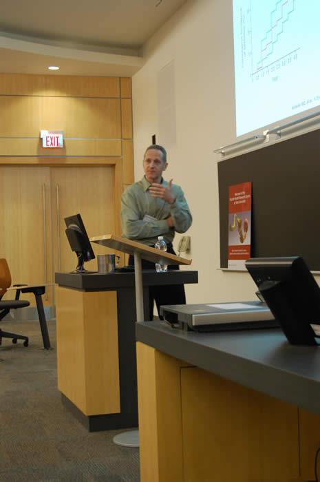 speaker presenting his slideshow in Life Sciences room