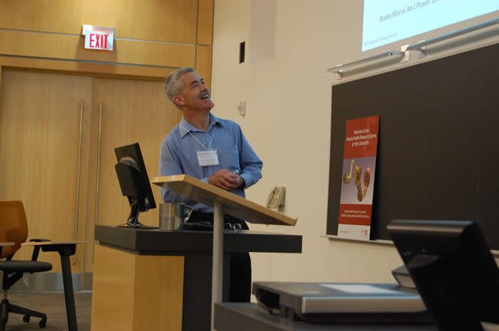 speaker advancing his slide show in Life Sciences room