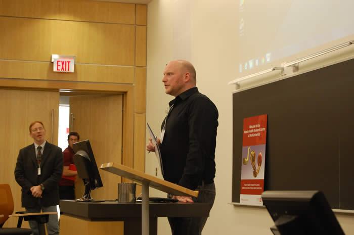 speaker addressing his audience in Life Sciences room