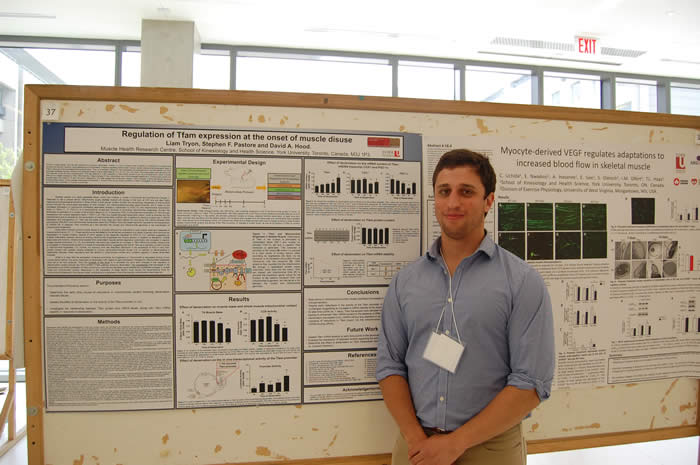 photo of presenter with his poster in Life Sciences Building