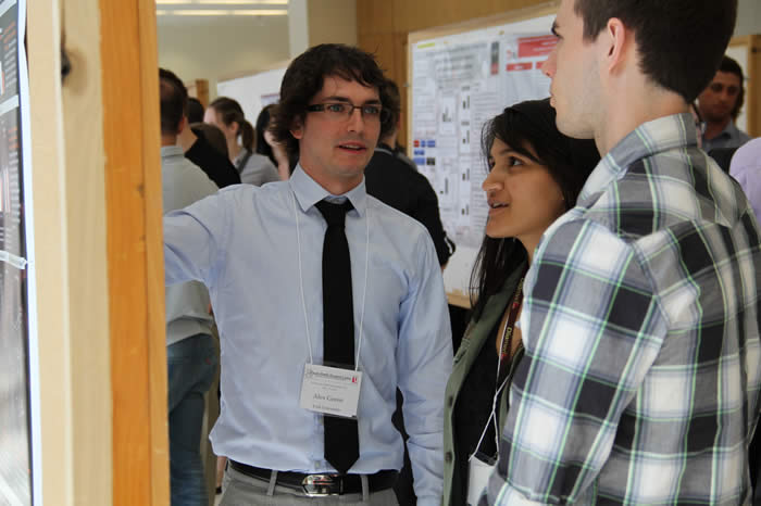 presenter engaging audience about his poster in Life Sciences Building