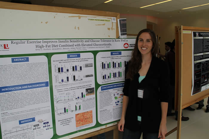 photo of presenter and her poster in Life Sciences Building